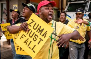 Supporters of a African National Congress Deputy President Cyril Ramaphosa reason placards and intone slogans outward a ANC celebration headquarter in Johannesburg, on Feb 5, 2018, during a proof to criticism opposite South African President and ANC member Jacob Zuma. Senior members of South Africa's ANC celebration will reason an puncture assembly Monday to plead either President Jacob Zuma should stay in bureau after he reportedly refused to resign. Some African National Congress (ANC) members are pulling for Cyril Ramaphosa, a new conduct of a party, to reinstate Zuma as boss immediately.