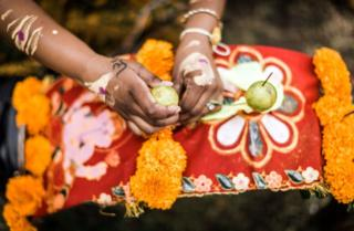 A Hindu advocate places fruit to adorn her 'Kavadi' (symbolic burden) during a annual Hindu Thaipoosam Kavady festival reason during Shree Emperumal Hindu Temple in Mount Edgecombe township, some 42 kms north of Durban on Feb 3, 2018.