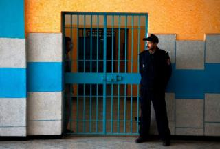 A jail supervisor stands ensure during a Oukacha jail in Casablanca on Feb 2, 2018.