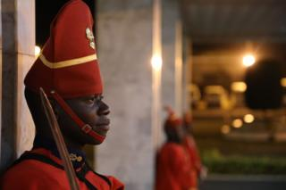 Senegalese ensure of respect waits during a airfield for a attainment rite of French President Emmanuel Macron during a airfield on Febuary 2, 2018, in Dakar.