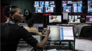 Staff work in a control during a news module during NTV studios in Nairobi on Feb 6, 2018. The Government away 3 vital Kenyan radio channels, NTV, KTN News and Citizen TV, during their live coverage of Raila Odinga as he swore himself in on Jan 30, 2018, as peoples president, notwithstanding losing in injured elections final year. NTV and KTN News resumed broadcasts yesterday though Citizen TV stays to promote on internet only.