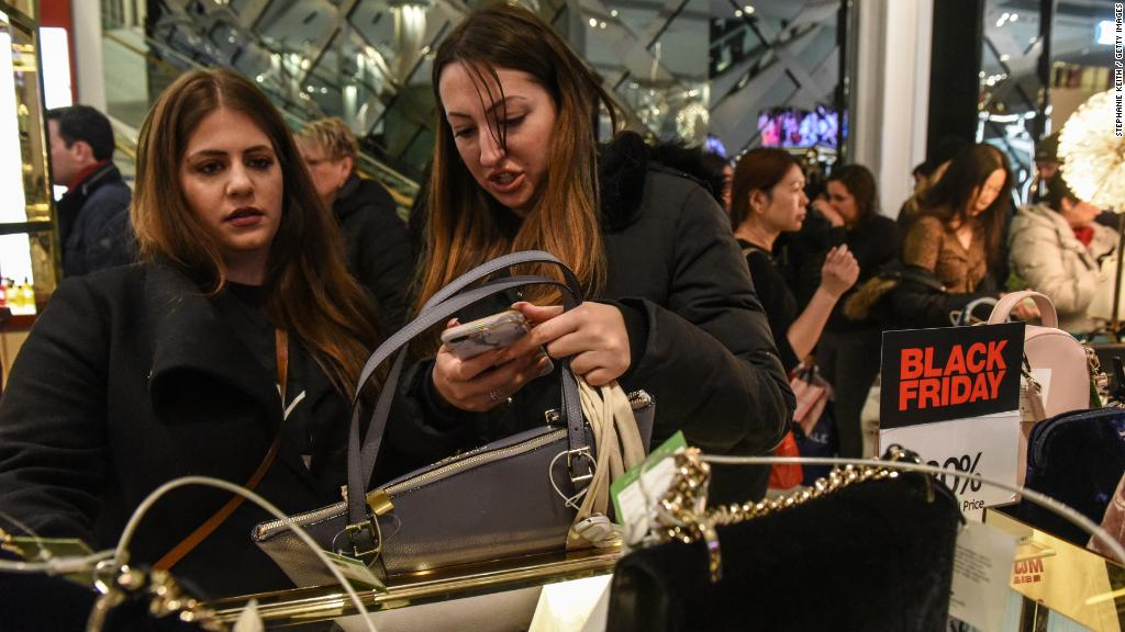Black Friday shoppers strike a stores on Thanksgiving Day