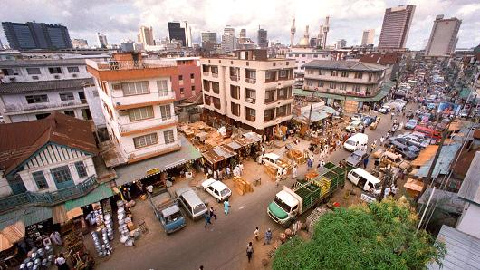 Jankara market, located on Lagos Island and a skyline of Lagos, Nigeria.