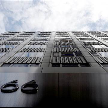A building during 666 Fifth Avenue, owned by Kushner Companies, rises above a travel in New York