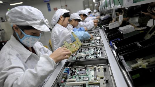 Chinese workers arrange electronic components during a Taiwanese record hulk Foxconn's bureau in Shenzhen, China.