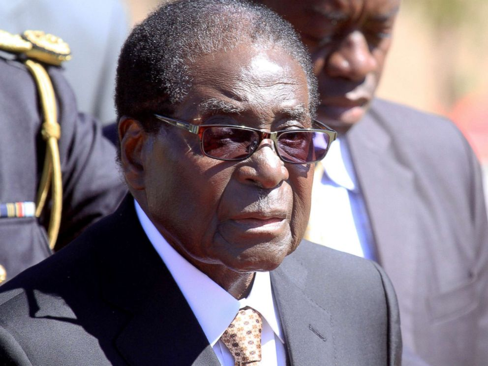 PHOTO: Zimbabwean President, Robert Mugabe, attends a funeral of Major General Bandama who died after a brief illness during a National Heroes hactare in Harare, Zimbabwe, July, 17, 2014.