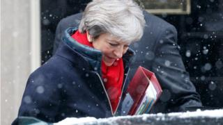 Theresa May in a snow