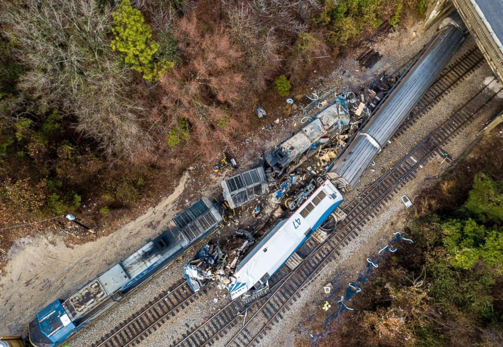 PHOTO: An aerial perspective of a site of an early morning sight crash, Feb. 4, 2018 between an Amtrak train, bottom right, and a CSX burden train, tip left, in Cayce, S.C.