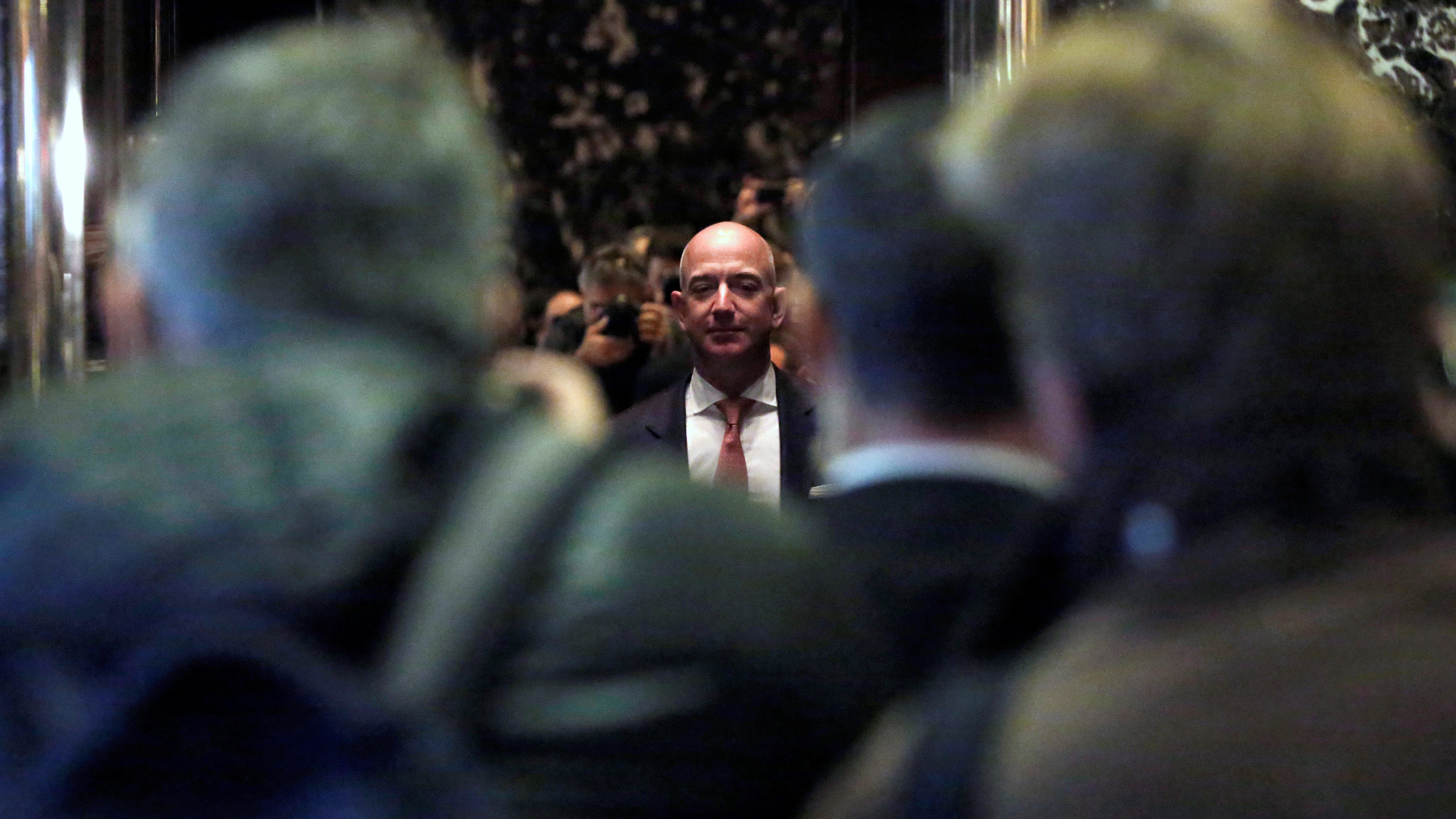 Jeff Bezos, founder, chairman, and arch executive officer of Amazon.com is photographed by media as he enters Trump Tower forward of a assembly of record leaders with President-elect Donald Trump in Manhattan, New York City, U.S.