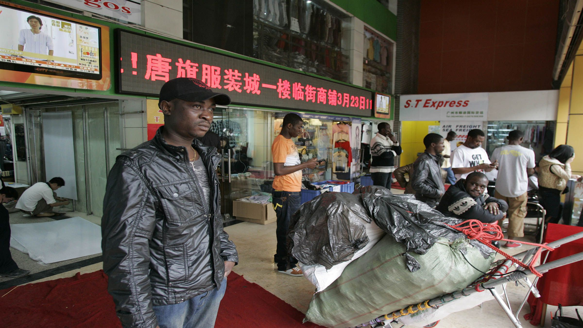 An African male stands nearby a offered mall in a southern Chinese city of Guangzhou in Guangdong operation Mar 27, 2009. In a past few years, tens of thousands of African and Arab traders have alive to trade hubs like Guangzhou and Yiwu to find their fortunes, sourcing inexpensive China-made products behind home to large markups in a growing, remunerative trade. Picture taken Mar 27, 2009. To compare underline FRICTION-CHINA/AFRICANS REUTERS/James Pomfret (CHINA POLITICS BUSINESS) - RTR26Y9O