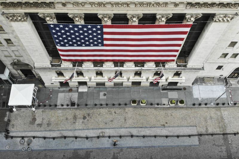 In this Mar 21, 2020 photo, a sole walking walks his dog past a New York Stock Exchange as COVID-19 concerns dull a typically bustling downtown area in New York. New York Gov. Andrew Cuomo announced unconditional orders Friday that will exceedingly shorten gatherings of any distance for a state's some-more than 19 million residents and will need workers in low businesses to stay home. (AP Photo/John Minchillo)
