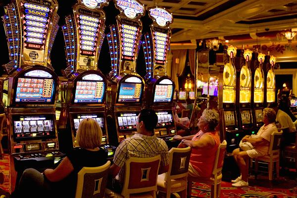People sitting during a bank of container machines during a Wynn Hotel and Casino is seen in this 2009 print in Las Vegas, Nevada.