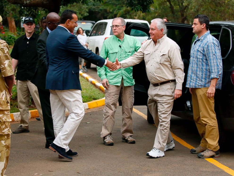 PHOTO: Kenyas Cabinet Secretary for Tourism Najib Balala (2-L) shakes hands with US Secretary of State Rex Tillerson (2-R) before to a debate of a Kenya Wildlife Service in Nairobi, on Mar 11, 2018.