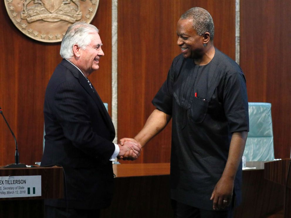 PHOTO: U.S. Secretary of State Rex Tillerson and Nigerias Foreign Minister Geoffrey Onyeama shake hands after their news discussion in Abuja, Nigeria, Mar 12, 2018.