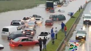 People station on a executive reservation demeanour during submerged vehicles on a flooded highway during inclement continue in Durban, South Africa, 10 Oct 2017