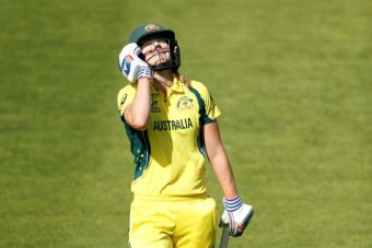 Ellyse Perry looking to a sky with a undone demeanour on her face.