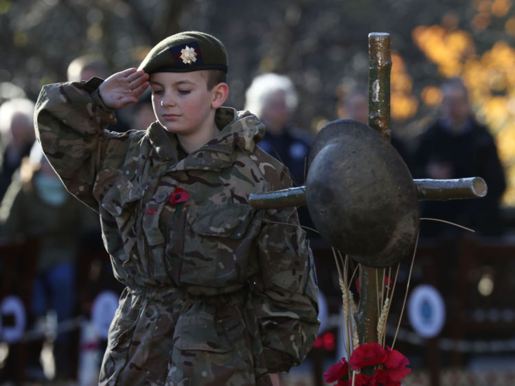 Army Cadet Force member Nathan Skinner salutes during a use in Edinburgh