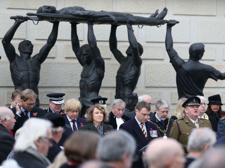 A two-minute overpower is celebrated during a National Memorial Arboretum in Staffordshire
