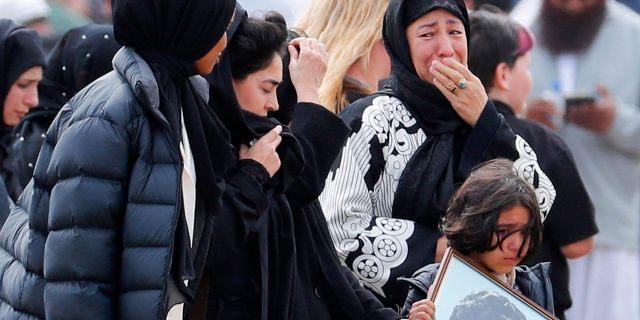 Mourners arrive for a funeral use of a plant from a Mar 15 mosque shootings during a Memorial Park Cemetery in Christchurch, New Zealand on Thursday. (AP Photo/Vincent Thian)