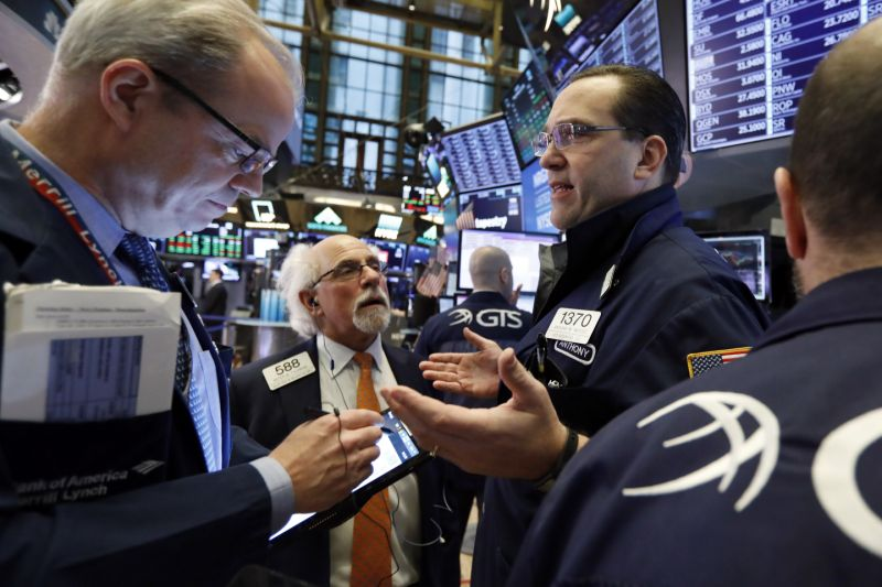 Specialist Anthony Matesic, right, works with traders on a building of a New York Stock Exchange, Friday, Feb. 15, 2019. Stocks are opening aloft on Wall Street after Chinese and U.S. officials concluded to continue trade talks in Washington subsequent week. (AP Photo/Richard Drew)