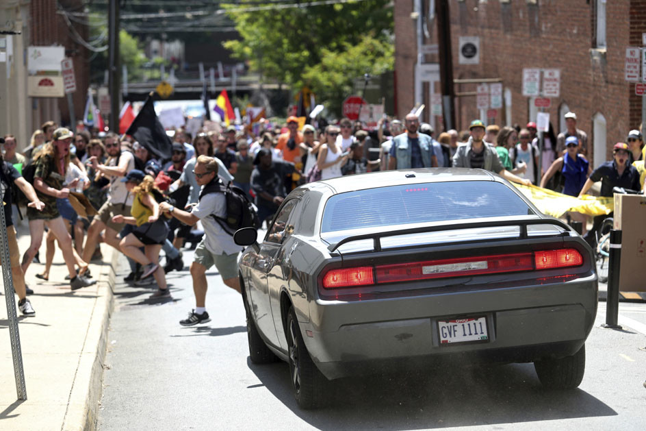 A automobile drives into a organisation of protesters. | AP Photo