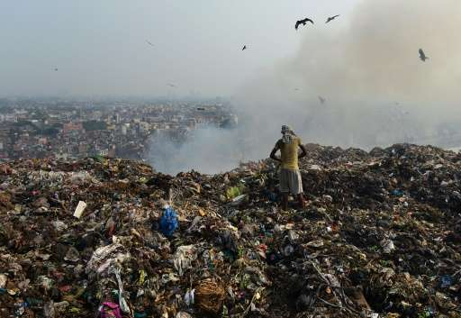 Locals vital circuitously a outrageous Ghazipur landfill in New Delhi site protest of ongoing headaches, wheezing and repeated bouts of f