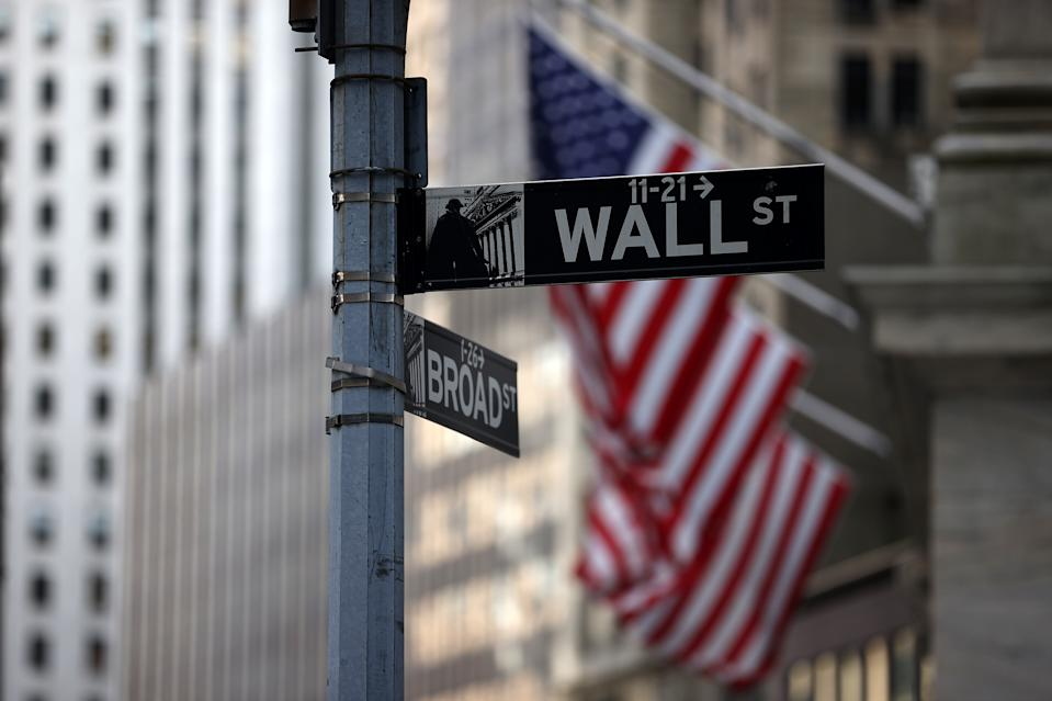 NEW YORK, NY - AUGUST 16: Wall St. and Broad St. signs are seen by a New York Stock Exchange (NYSE) building in a financial district of New York City, United States on Aug 16, 2021. (Photo by Tayfun Coskun/Anadolu Agency around Getty Images)