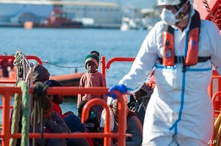 A child stands on a rescue vessel as he arrives with a organisation of migrants discovered by Spanish nautical authorities during Motril port…