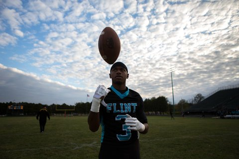 Jaguars using behind Cortez Jackson throws a football around before a home diversion opposite Saginaw High.