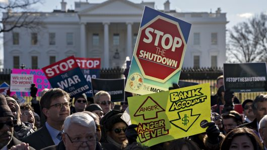 A malcontent binds a 'Stop The Shutdown' pointer during a convene with kinship members and sovereign employees to finish a prejudiced supervision shutdown outward a White House in Washington, D.C.