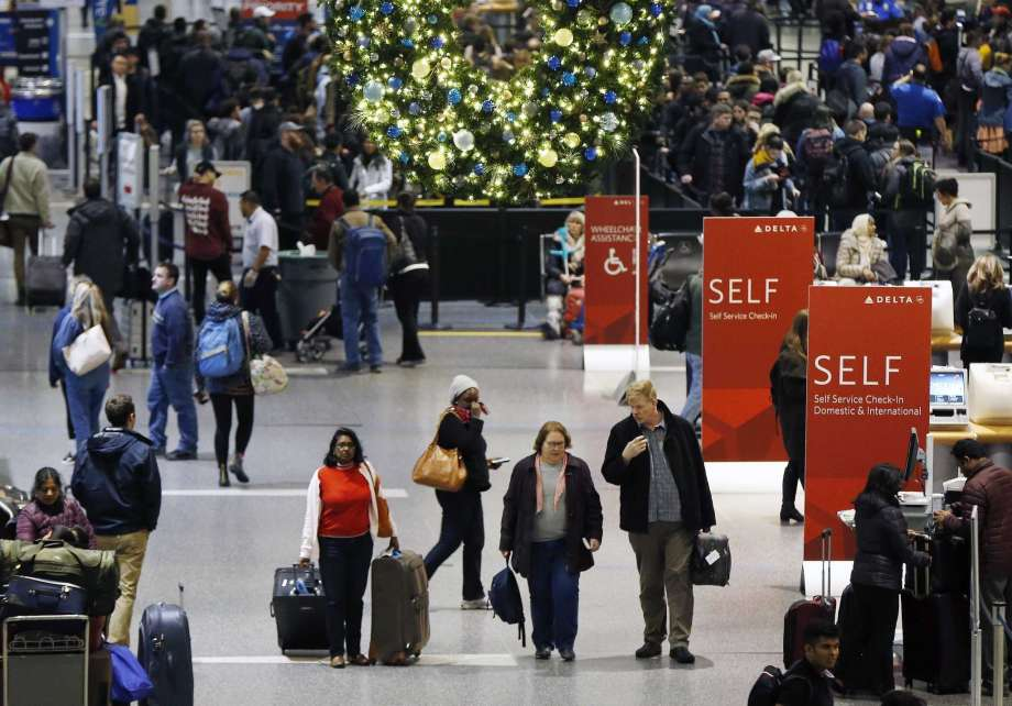 FILE - In this Wednesday, Nov. 22, 2017, record photo, passengers pass by Terminal A during Logan International Airport in Boston. ItÂ?s removing late for engagement holiday travel, though not too late. Experts contend there are tips for procrastinators to find affordable airfares and hotel rooms. Flexibility is a key. (AP Photo/Michael Dwyer, File) Photo: Michael Dwyer, STF / AP2017