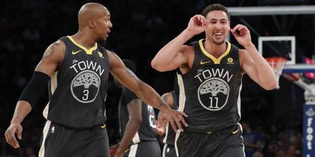 Golden State Warriors brazen David West (3) and ensure Klay Thompson (11) conflict toward their dais during a second half of an NBA basketball diversion opposite a New York Knicks, Monday, Feb. 26, 2018, in New York. (AP Photo/Kathy Willens)