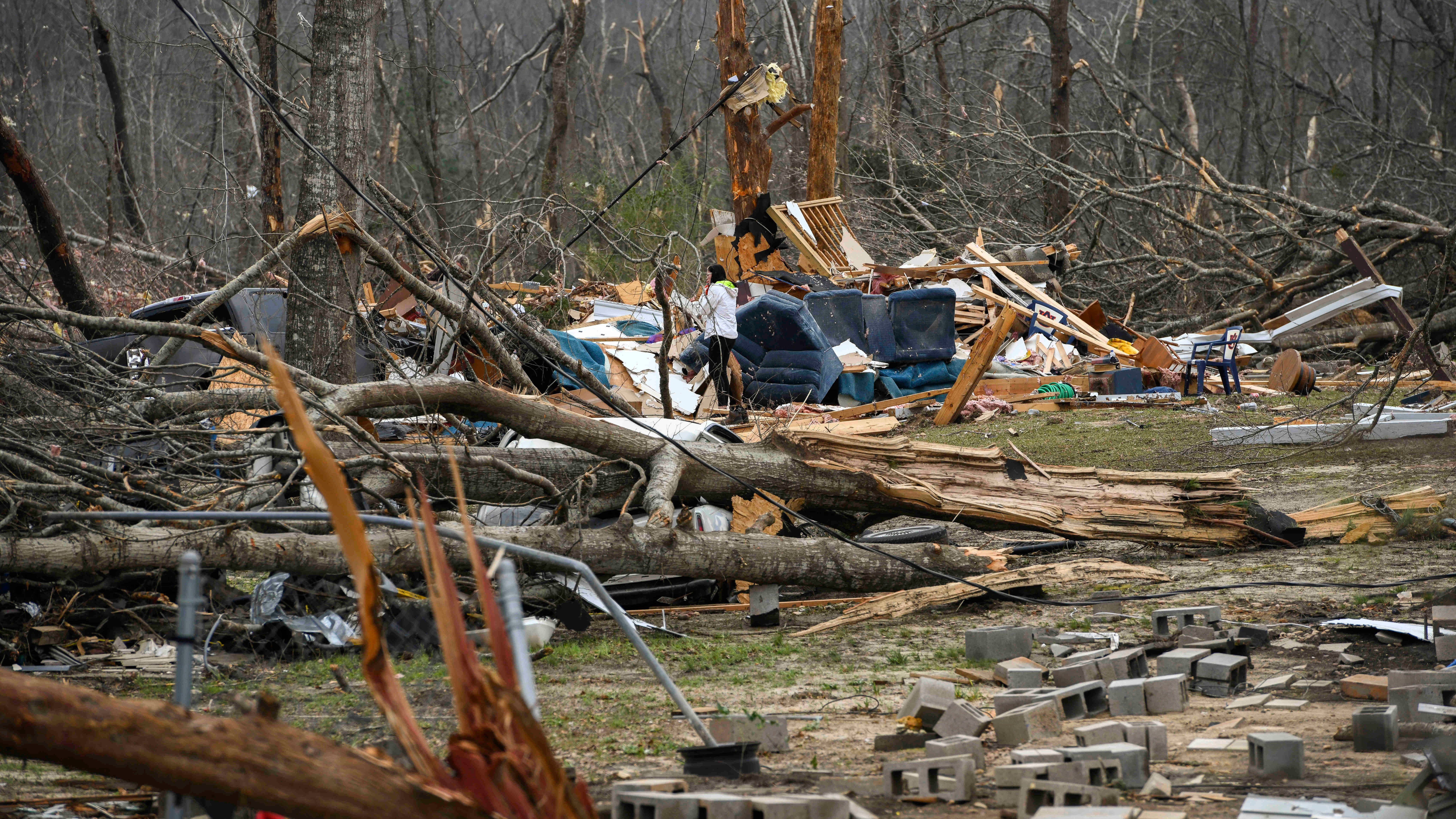 Brittney Downs looks by a waste of a family member's shop-worn home a day after a lethal whirly scorched a area, in Beauregard, Ala., Monday, Mar 4, 2019. (AP Photo/Julie Bennett)