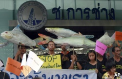 FILE - Thai villagers reason banners hostile a building of a dam on a Mekong stream during a convene outward a construction association in Bangkok, Thailand, Apr 24, 2012. A new irrigation offer — a Kong-Loei-Chi-Mun plan — is sparking concerns from locals, environmentalists, and some growth experts.