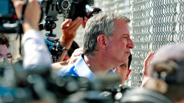 FILE - In this Thursday, Jun 21, 2018, record photo, New York City Mayor Bill de Blasio looks by a sealed embankment during a Port of Entry facility, in Fabens, Texas, where tent shelters are being used to residence distant family members. U.S. Customs and Border Protection is alleging that de Blasio illegally crossed from Mexico into a U.S. while visiting a El Paso, Texas, area in June, an indictment a mayorâ??s bureau flatly denies. (AP Photo/Matt York, File)