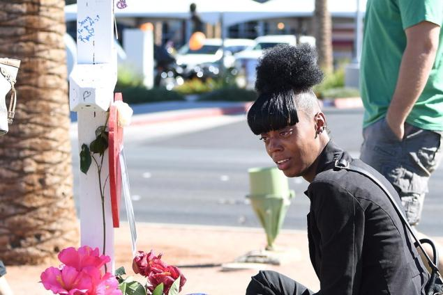 CSC Security ensure Jamika Washington mourns during a cranky honoring her co-worker Erik Silva who was killed during a Route 91 Harvest nation song festival Oct 6, 2017 in Las Vegas, Nevada.