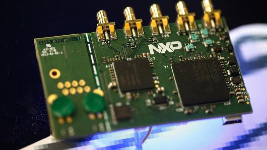 Microprocessors lay on a circuit house displayed on a NXP Semiconductors NV pavilion during a Mobile World Congress in Barcelona, Spain, on Monday, Mar 2, 2015.