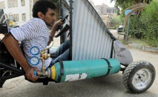 Mahmoud Yasser, automatic engineering tyro from Helwan University, drives an air-powered automobile in Cairo, Egypt - Tuesday 7 Aug 2018