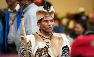 A male in normal Khoi San regalia waits before a land sequestration conference being hold in a church in Cape Town - Friday 4 Aug 2018