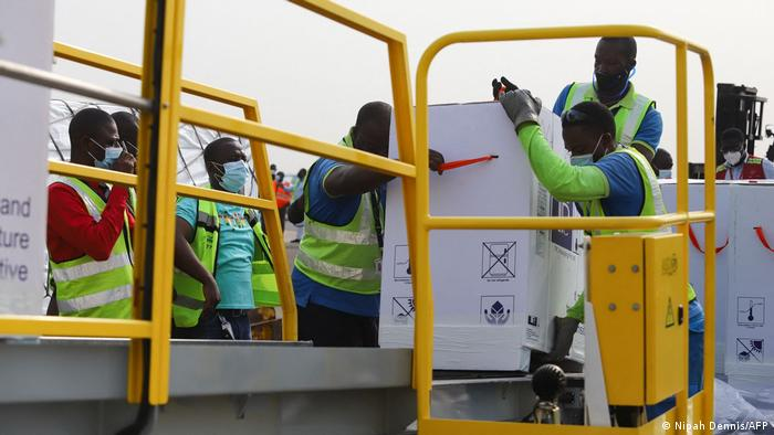 Ghana airfield workers offload COVID-19 vaccines