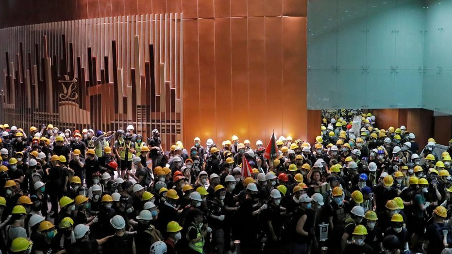 Hong Kong military questioning crime stage after protesters forage council building