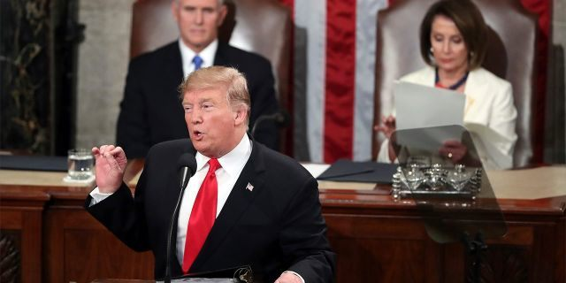 President Trump delivers his State of a Union residence on Tuesday night, flanked by Vice President Mike Pence and House Speaker Nancy Pelosi. (AP Photo/Andrew Harnik)