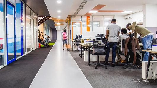 Andela developers collaborating in newly non-stop Nigerian Headquarters.