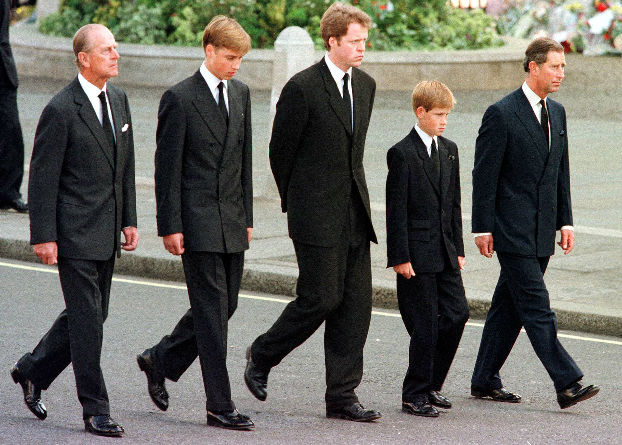 Prince Philip, Prince William, Earl Spencer, Prince Harry and Prince Charles transport outward Westminster Abbey during a wake use for Princess Diana