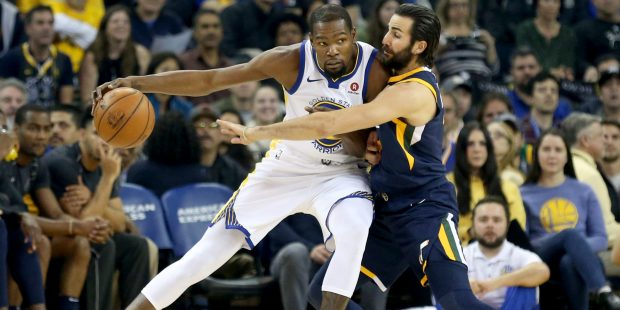 Golden State Warriors' Kevin Durant (35) pushes in on Utah Jazz's Ricky Rubio (3) in a initial duration of their NBA diversion during Oracle Arena in Oakland, Calif., on Wednesday, Dec. 27, 2017. (Anda Chu/Bay Area News Group)