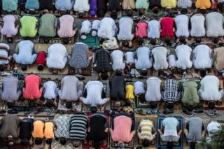 Egyptian Muslims perform a Eid Al-Adha morning request in collateral Cairo on 11 Aug 2019.