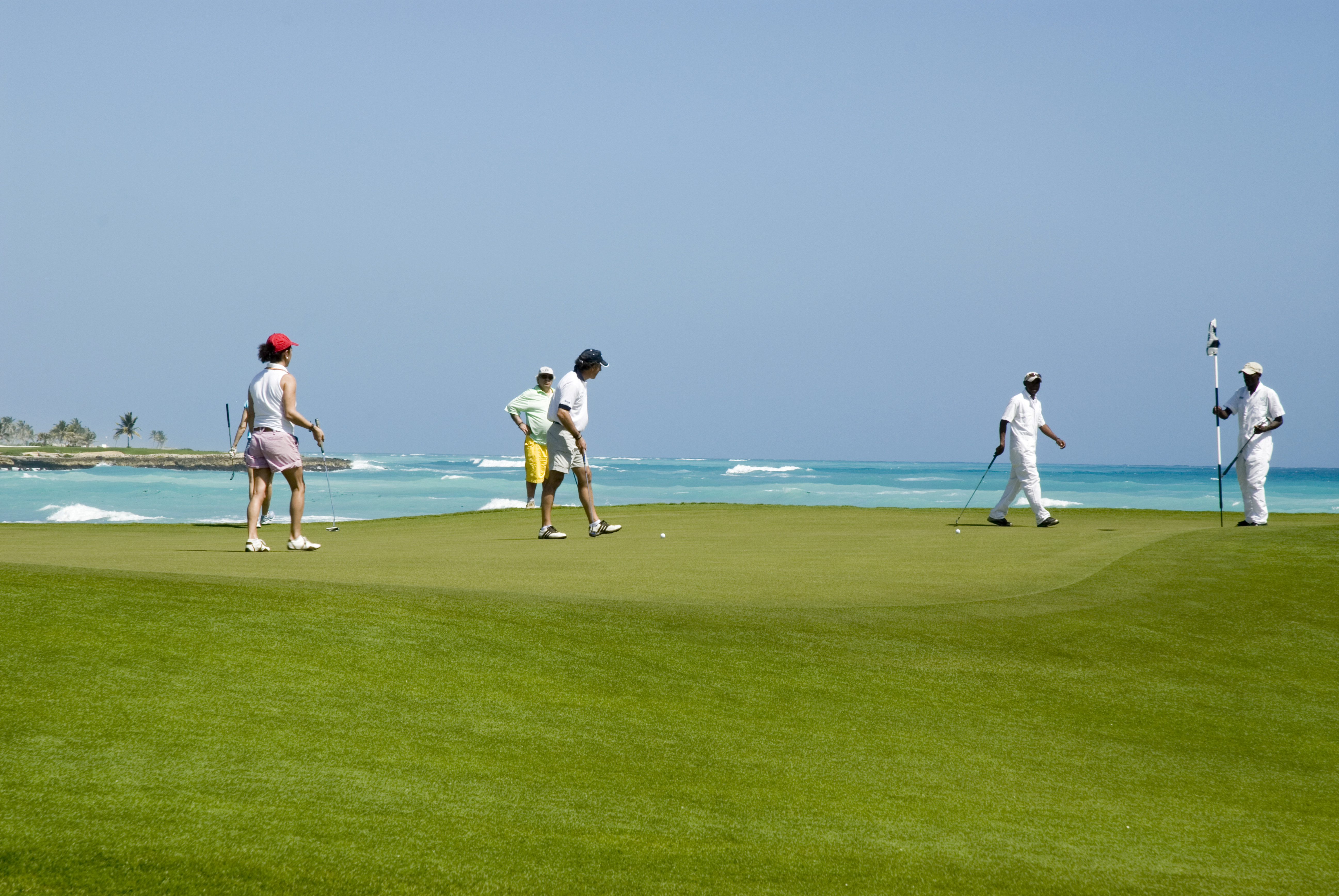 Golfers play a diversion in Punta Cana, Dominican Republic.