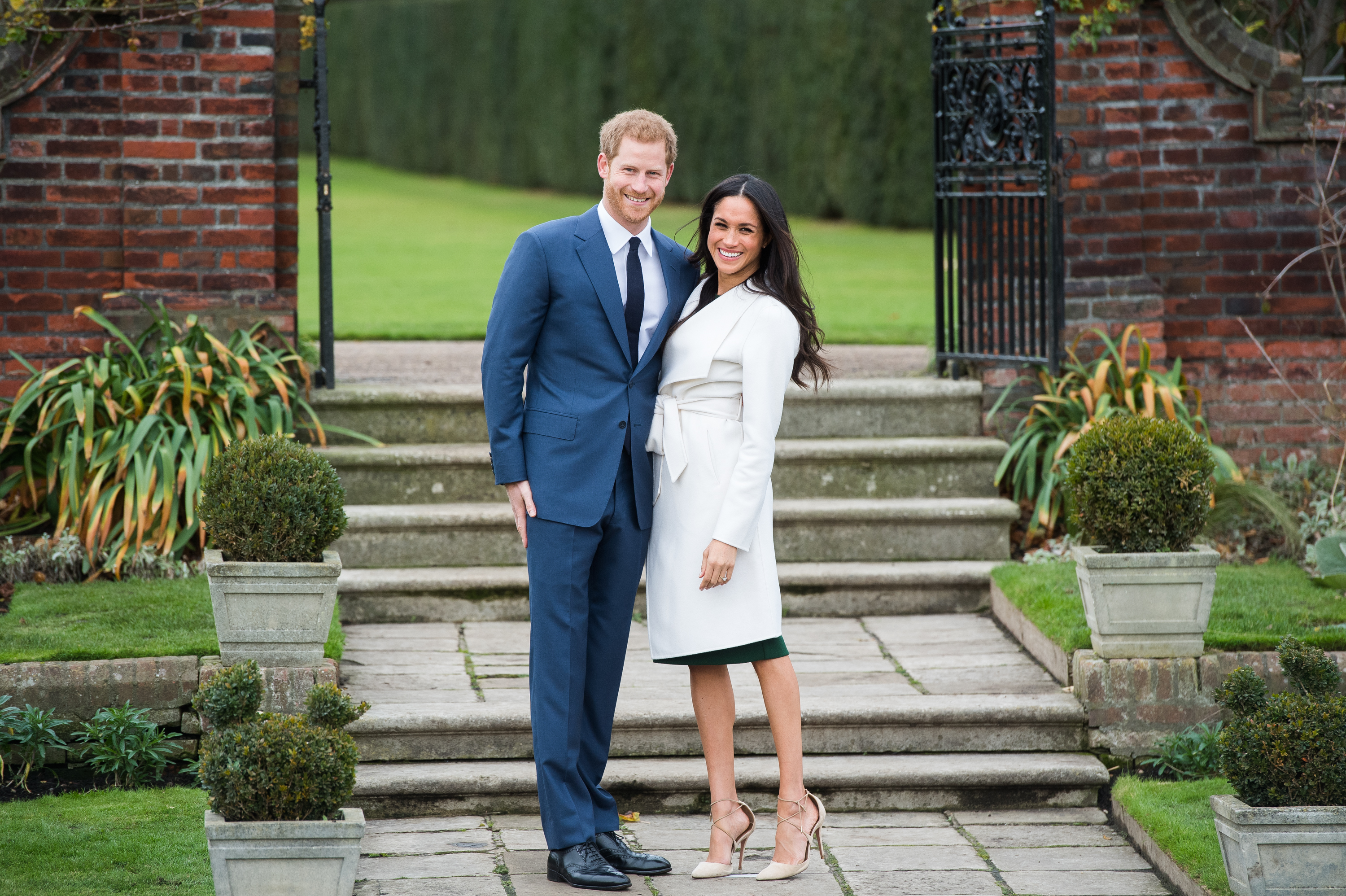 Prince Harry and Meghan Markle during an executive photocall during The Sunken Gardens during Kensington Palace to announce their rendezvous on Nov 27, 2017. Samir Hussein—Samir Hussein/WireImage