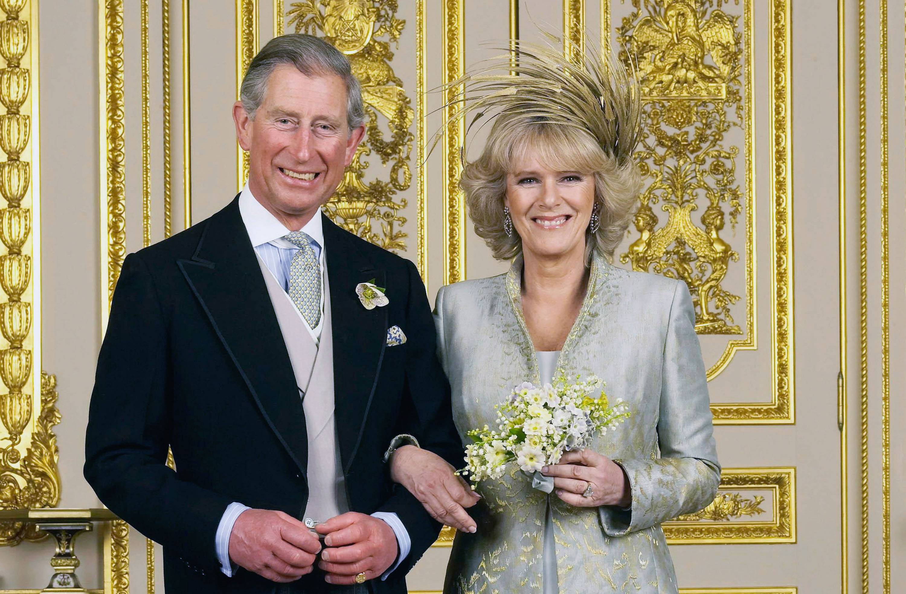 Prince Charles, a Prince of Wales, and his mother Camilla, a Duchess Of Cornwall, poise in a White Drawing Room during Windsor Castle for a Official Wedding sketch following their matrimony on Apr 9, 2005 in Windsor, England. Tim Graham/Getty Images