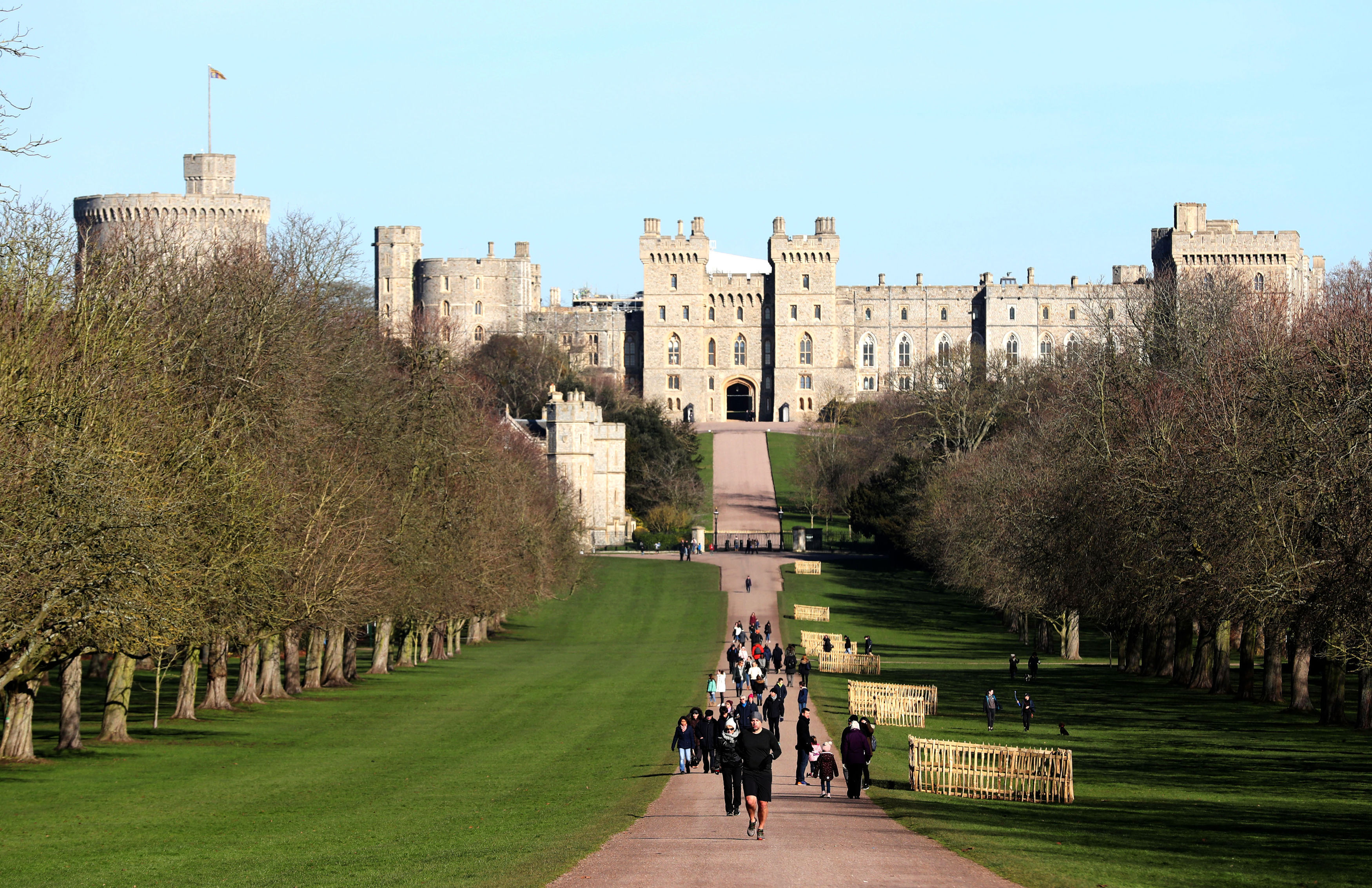 Blue skies over Windsor Castle in Berkshire, as people travel along a Long Walk. Steve Parsons - PA Images—Getty Images